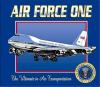 Air Force One T-Shirt - Flying Air Force One would certainly be flying 'First Class'. This classy design is printed on the front of an 'Executive Royal Blue' shirt. The aircraft has all the additional antenna and other details. The Presidential Seal is there also, with highlights in metallic gold. At the top is the Air Force One lettering in a simulated chrome effect.